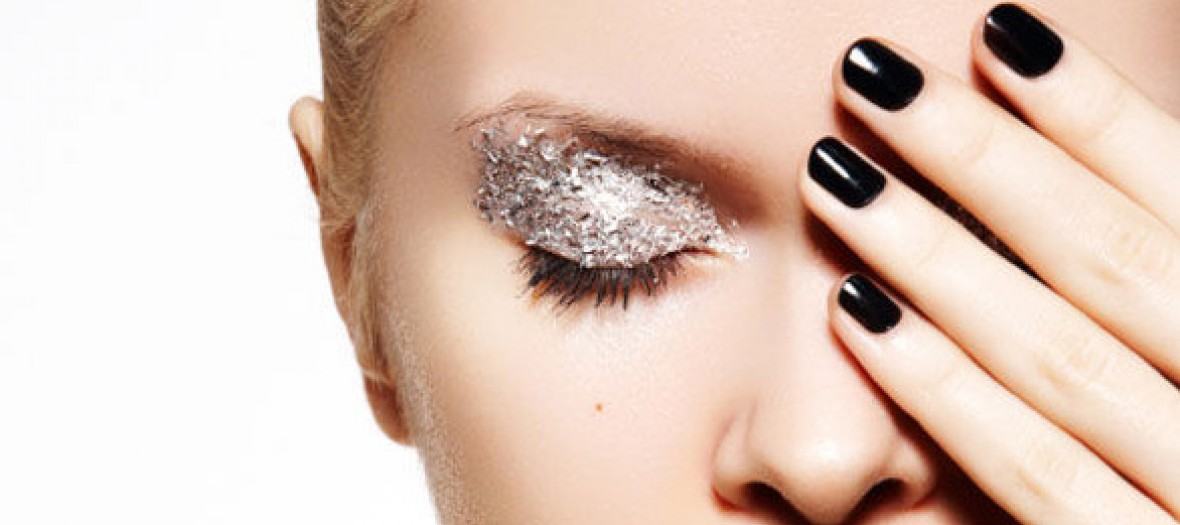 Woman With Silver Glitter Eye Make Up And Black Nail Polish Arti