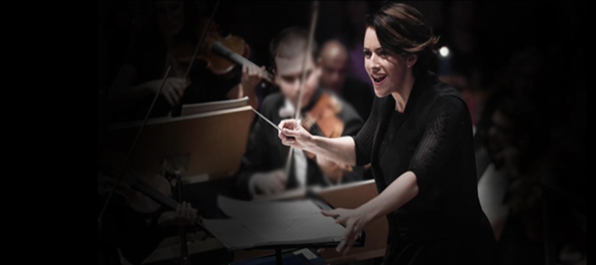 Alondra de la Parra conducting an orchestra