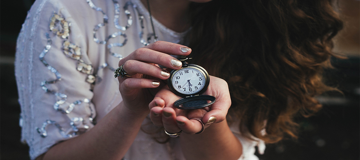 Woman holding a watch