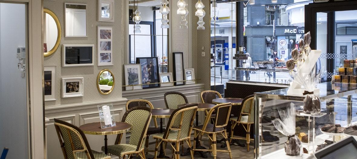 Interior atmosphere and decoration of the Michel Cluizel Tea Room with paintings, chocolates, caramels, pralines
