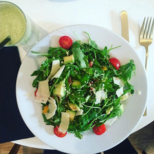 veggie salad with avocado, boulgour, quinoa, arugula and orange vinaigrette