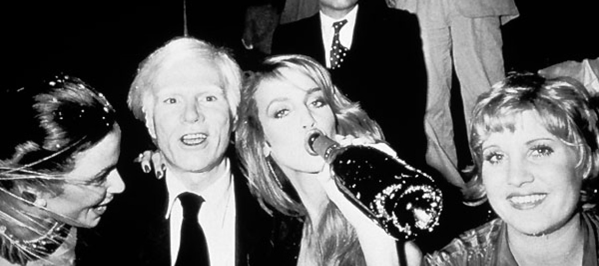 Andy Warhol, Jerry Hall and their friends who make party at club 54 in New York