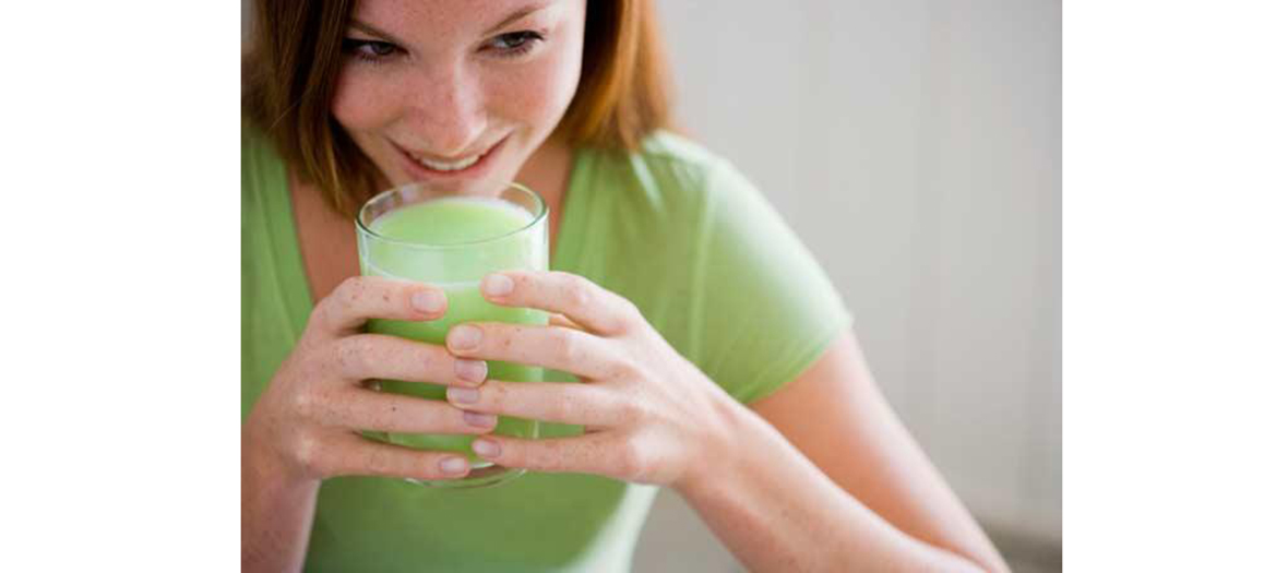 woman eating aloe vera juice