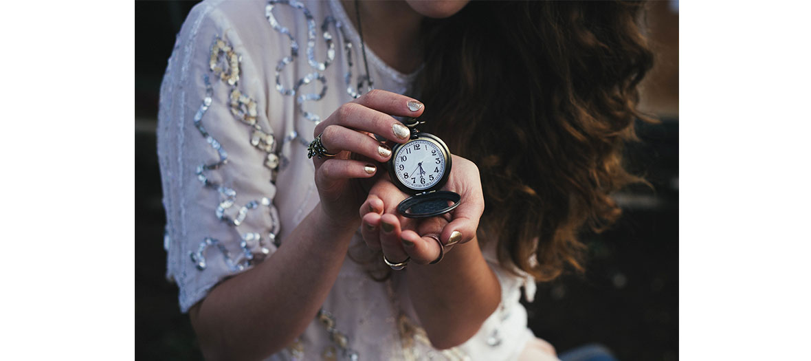 Girl holding a watch