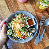 Thai and vegan restaurant, interior and salad restaurant dish with spring rolls