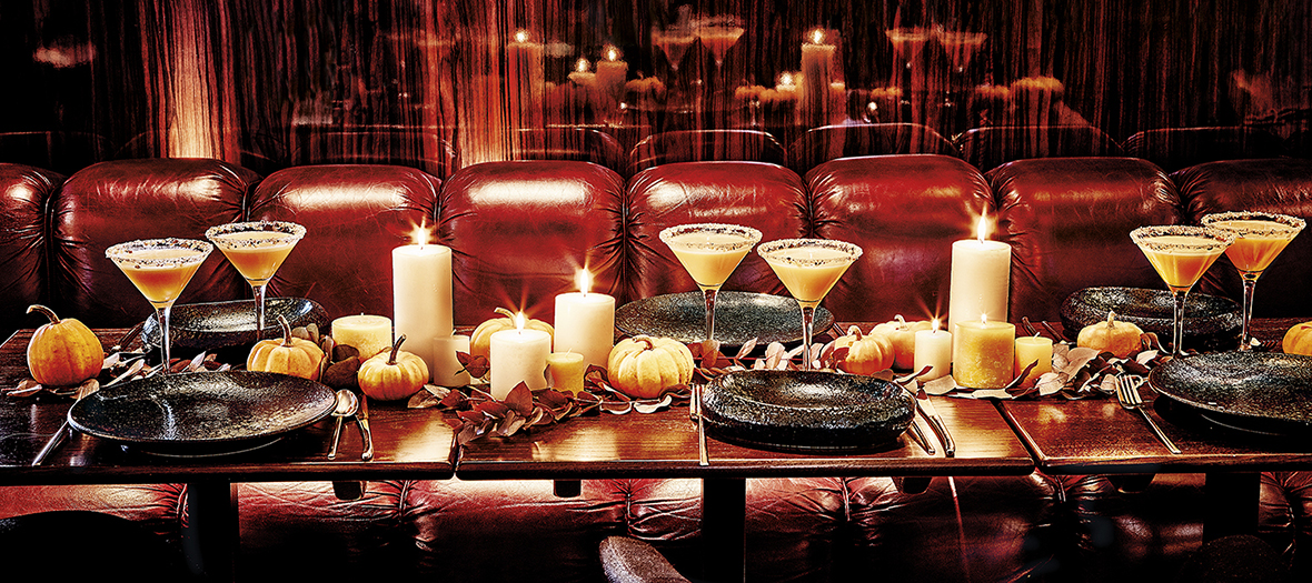 Table decorated for Thanksgiving, cocktails, candles, pumpkin at the drugstore brasserie in the Champs Elysées in Paris