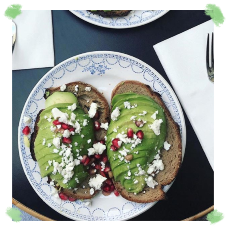 Avocado toast with Toasted country bread, pimped with an avocado sliced as a carpaccio, fresh cheese, a pomegranate and a small portion of arugula with or without egg and smoked salmon of Maison sauvage in Paris