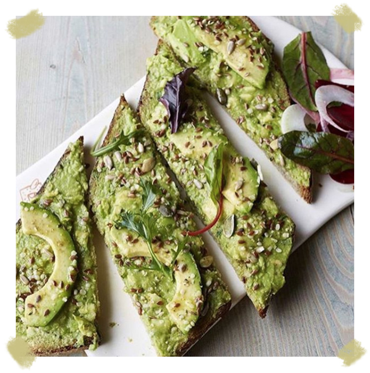 pain quoitidien avocado toast with Poilane bread and roquette salads in Paris