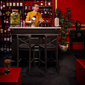The barman chef Clément Emery at the cocktail bar and the bar interior