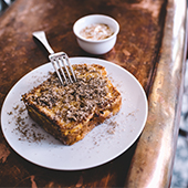 A piece of French toast made of stale bread, dipped in milk, then mixed with eggs and sugar