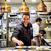 Portrait of Chef Denny Imbroisi in Kitchen and Decoration of IDA Restaurant