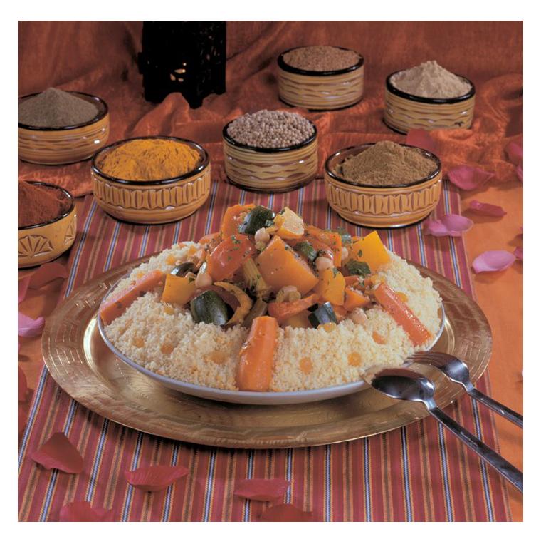 Couscous skewer of veal, lamb chop, dumplings, merguez, broth, vegetables