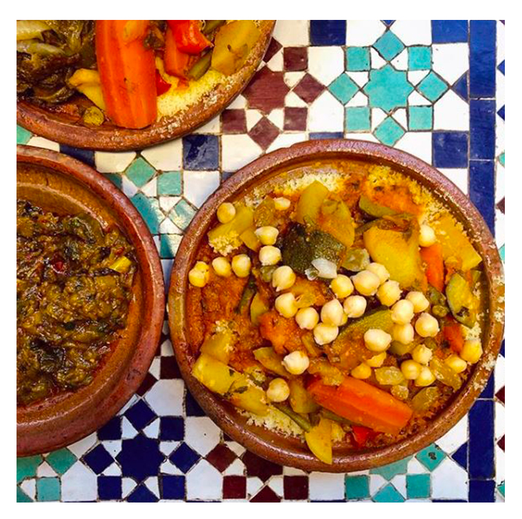 Couscous dish with semolina, vegetables, broth, merguez, aubergine stuffed minced meat, kefta, chicken