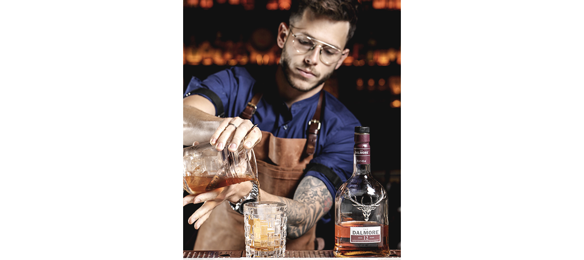 Portrait of the bartender chef Eric Sablonnière preparing a cocktail at the Roxo restaurant