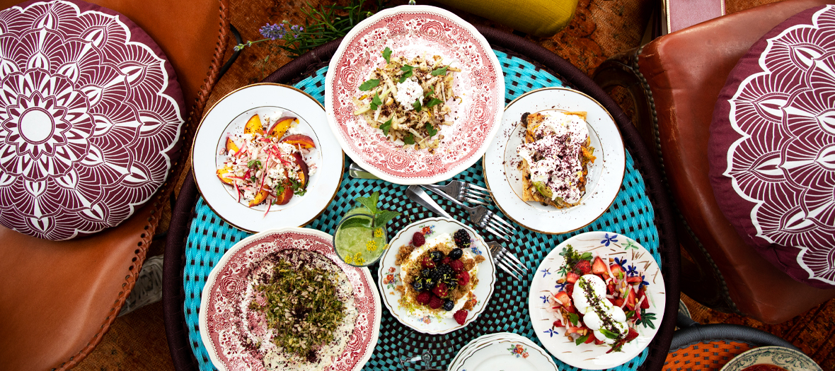 Plate to share including,  potato salad, egg, red onion and capers, salty salad with peaches, spring onions, radish and feta, mozzarella and gariguette strawberries or a focaccia with flower of courgettes and burrata