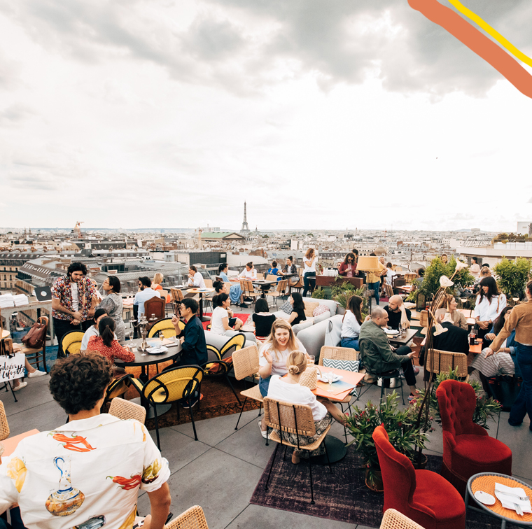 People having a happy hour on the Créature rooftop Galeries Lafayette Haussmann in Paris