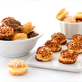 Bowls of tropezienne mini pies with natural flavors, chocolate, coffee, hazelnut