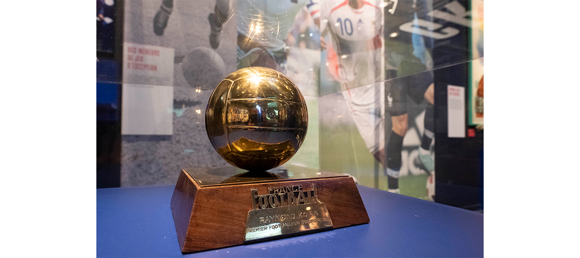 golden ball trophy of Raymond Kopa exposed in a showcase at institut du monde arabe