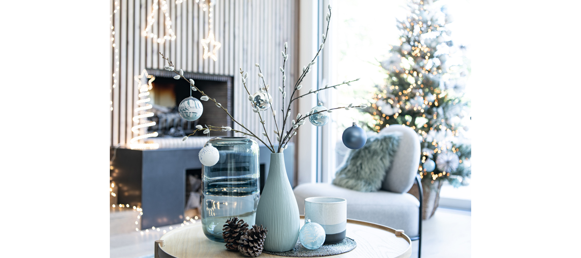 Ice Christmas collection from maison du monde that includes white palm tree leaves, branches of frosty eucalyptus and Christsmas balls with a polar ice print.