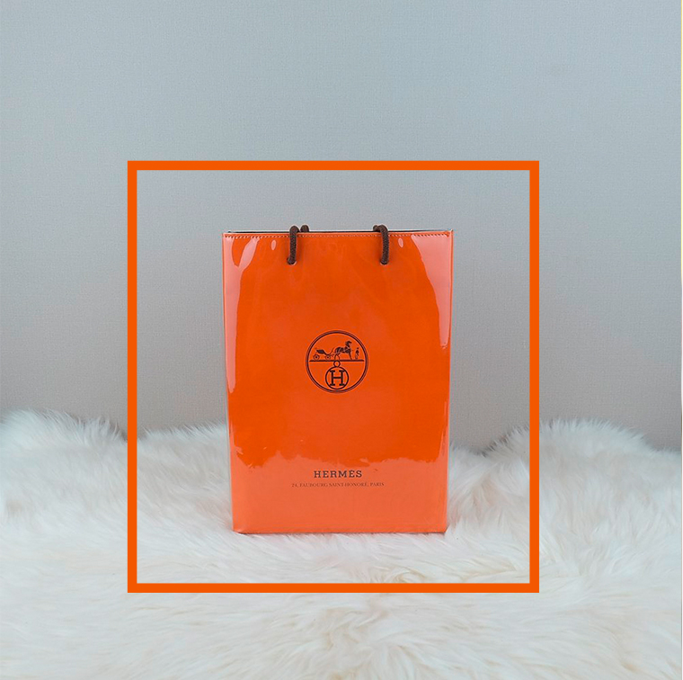 Orange bag with Ink Chain at Hermès