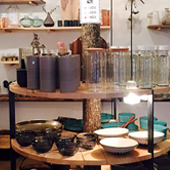 Decoration of the Mano Workshop with vases, cardboard graphic goblets, small Japanese ceramics, plates and sea salt