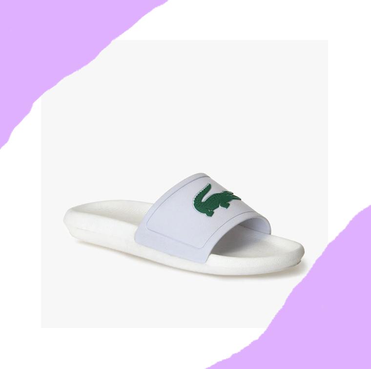 Claquettes blanches en caoutchouc avec logo