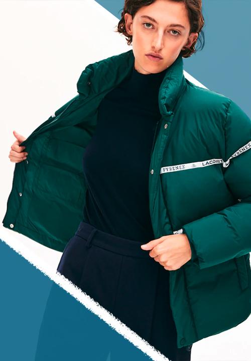 Doudoune unisexe Lacoste Pyrenex avec Capuche avec cordons de serrage, Fermeture zippée, 2 poches sur les côtés et poche intérieure, Deux rubans Lacoste x Pyrenex sur le devant, Crocodile vert brodé bas de vêtement.