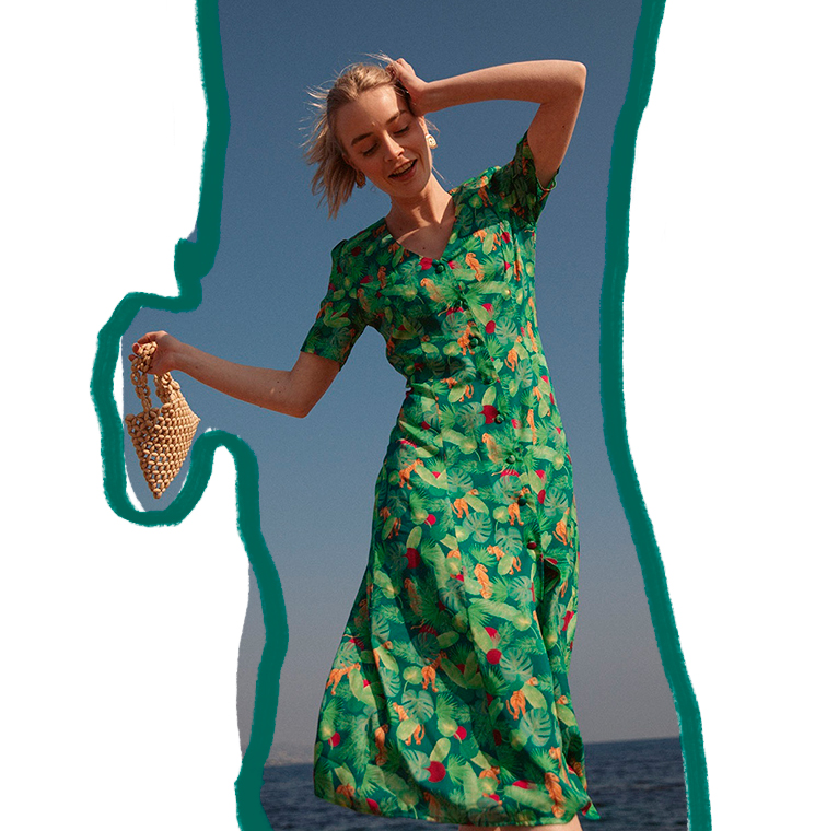 fcb9261974 Young girl wearing midi verte dress from Soi Paris