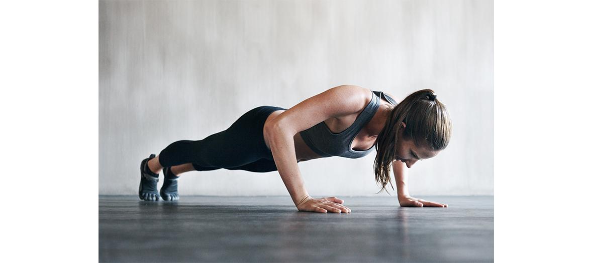 Young girl making push ups
