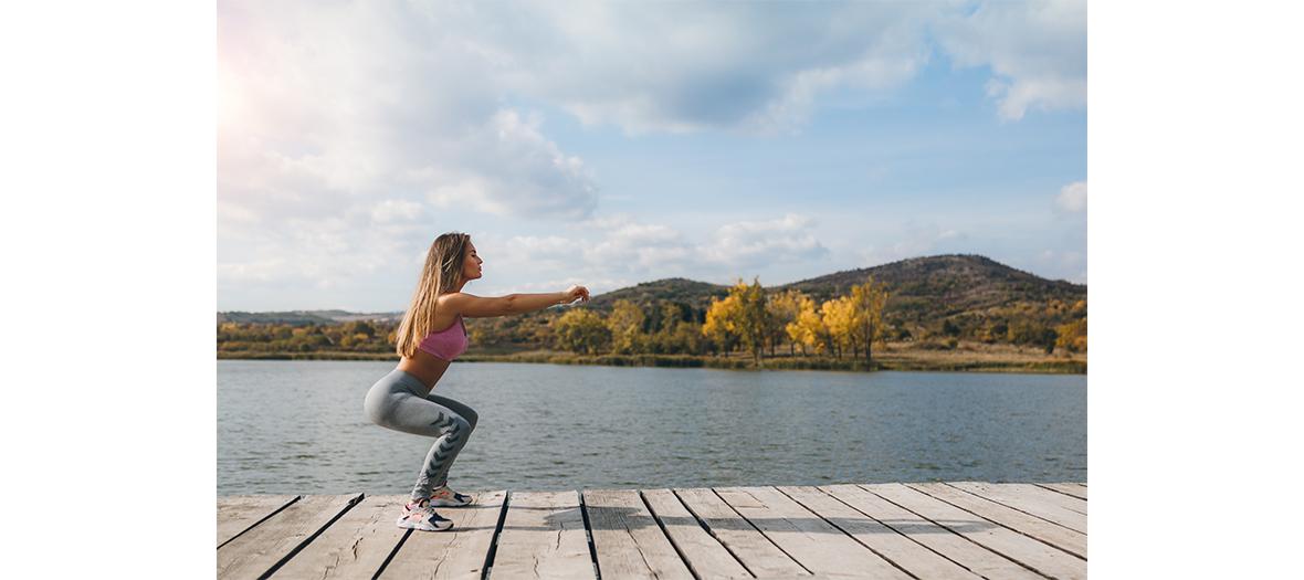 Young woman making squats