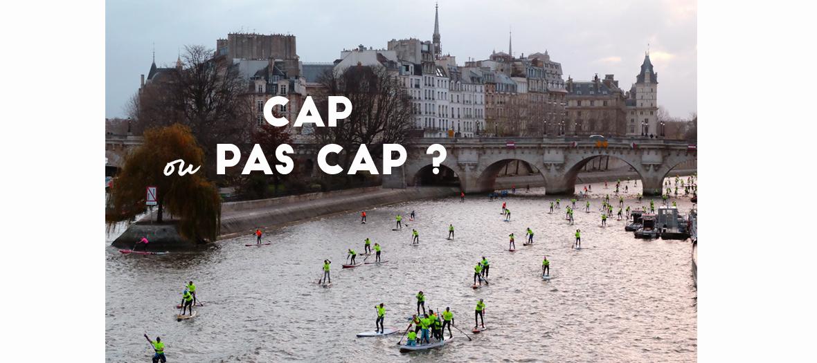 Course de paddle sur la Seine à Paris près de l'ile Saint-Louis