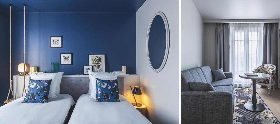 Hôtel lobby haussmannien, imprimés fleuris, murs bleus canard, carreaux de ciment et lits XXL