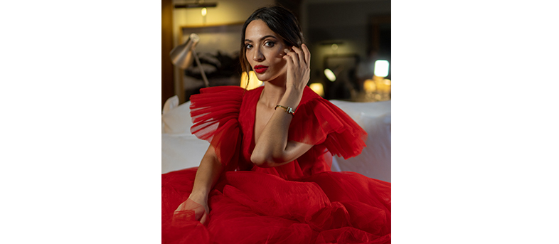 sofia benkazour wearing a red dress at the Royal Monceau Raffles paris