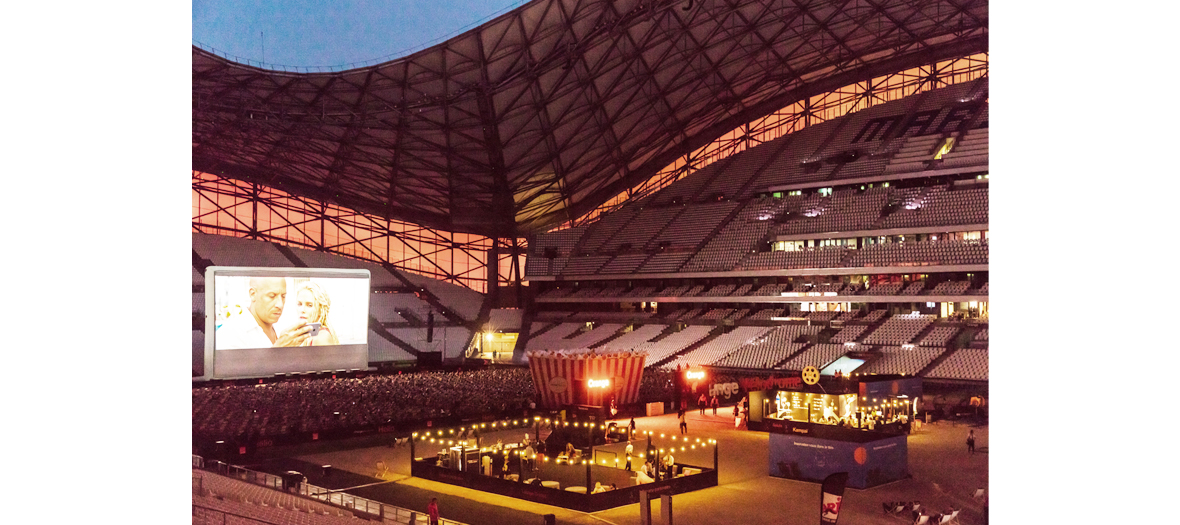 Outdoor projections of the movie Mad Max : Fury Road at the Vélodrome stadium in Marseille