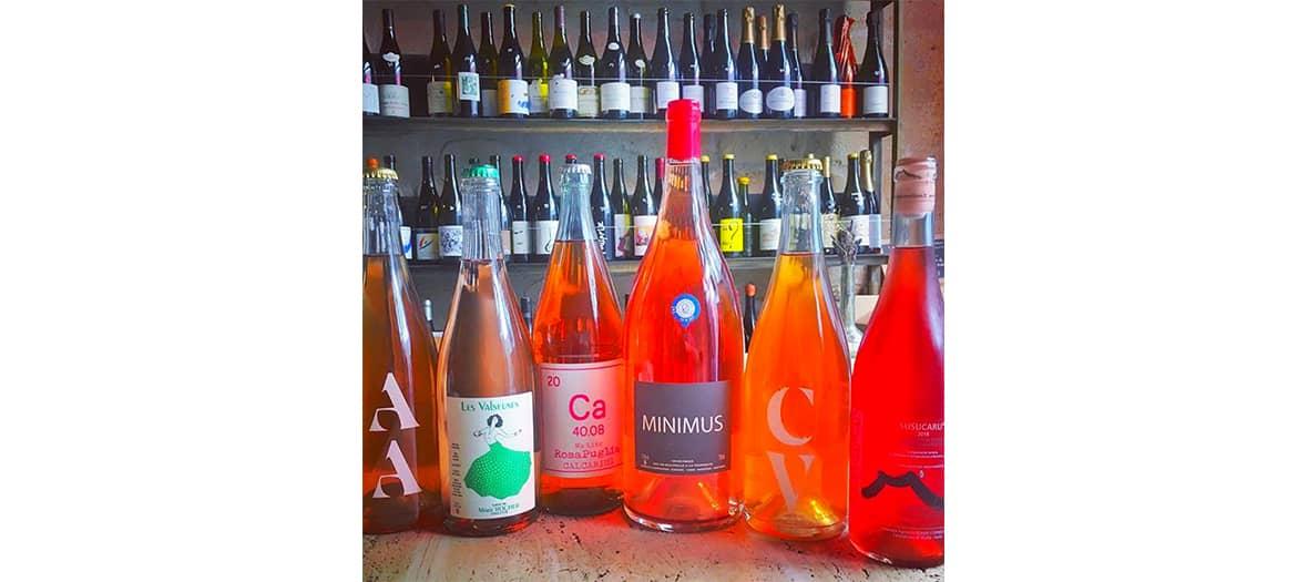 Orange wine bottles at Augustin organic wine bar in Paris