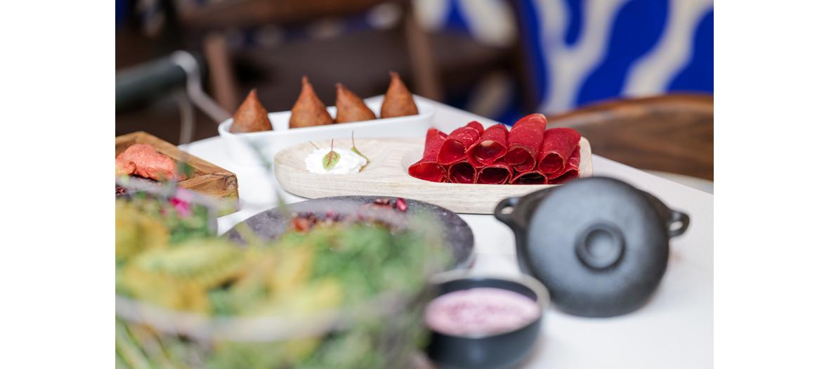Mezze with Jerusalem artichoke caviar, pomegranate octopus, meat samosas, hummus / lamb hazelnut, smoked eel falafel