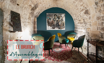 Brunch Assemblages wine cellar spirit with a perfect cosy decor mingling stone wall, modern furniture, arty paintings and Persian carpets