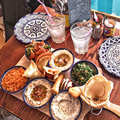 Decoration with teapots, pockets, Aleppo soap, wicker baskets, rose syrups and Arayes, falafels, vegetarian mezes dishes from L'Artisan Libanais restaurant