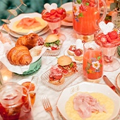 Room decoration and croissant table, squeezed fruit juice, strawberries, madelaine, bread and tea from Patisserie Bontemps