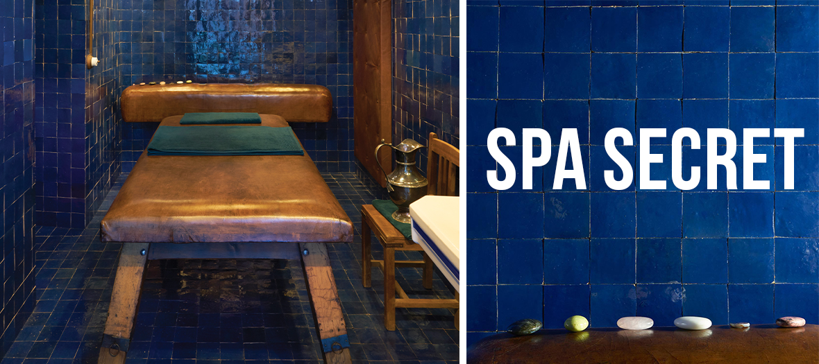 cabin massage with Blue tiles, leather table, an incredible composition of dried flowers on the ceiling, sound track signed Jean-Sébastien Bachand candles to embalm the atmosphere with an almost monastic fragrance at Officine Buly in Paris